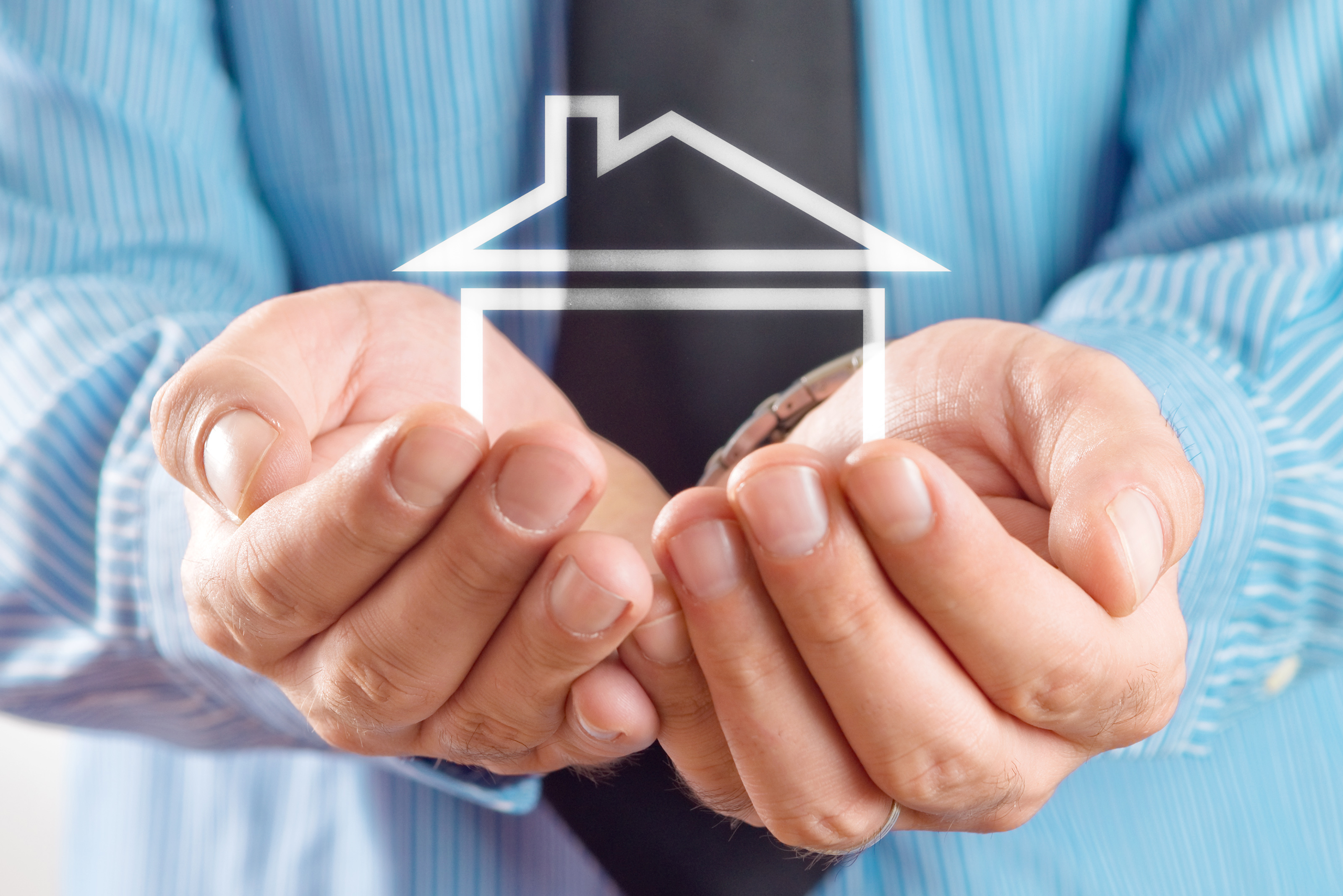 House In Hands Of Businessman